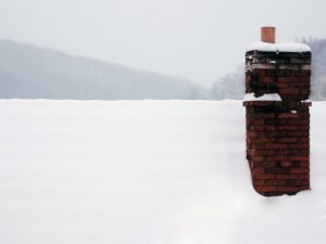 How Snow and Ice Can Damage Chimneys